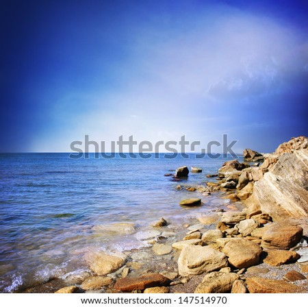 Beautiful sky and blue ocean - stock photo