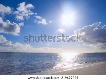 Beautiful sky and blue ocean - stock photo