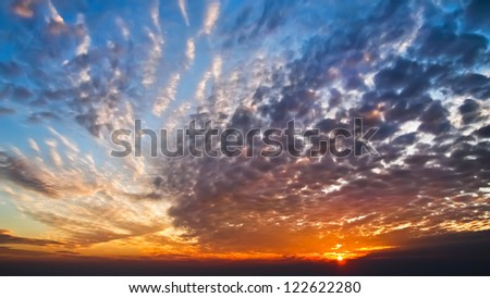 Beautiful sky and cloud in last beam of the sun - stock photo