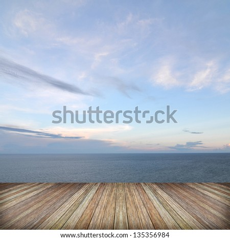 Beautiful sky and ocean with wooden berth - stock photo