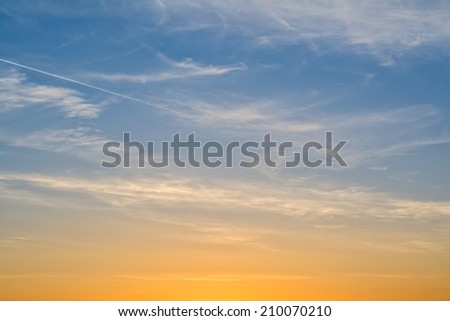 beautiful sky at sunset with clouds and vivid colors - stock photo