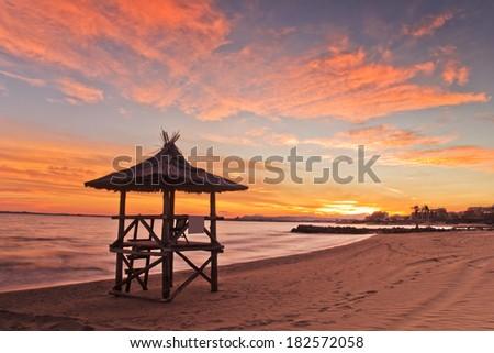 Beautiful sky of sunset on the beach - stock photo