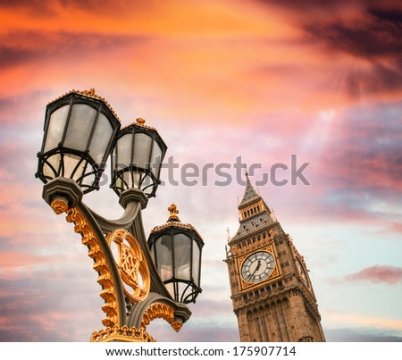 Beautiful sky over Big Ben and classic London lamp post. - stock photo