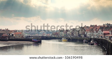 beautiful sky over the port of Whitby - stock photo