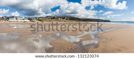 Beautiful sky reflected in pools of water on the beach at Praa Sands Cornwall England