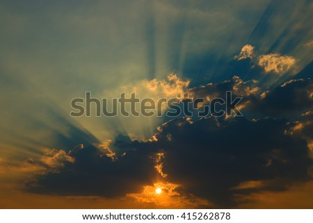 Beautiful sky with clouds and sun rays at sunset