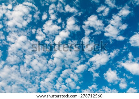 Beautiful sky with cotton clouds - stock photo