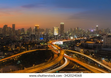 Beautiful skyline of Bangkok City downtown and road interchanged after sunset