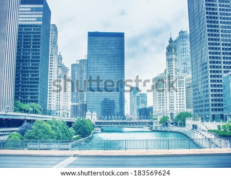 Beautiful skyline of Chicago with river and skyscrapers. Vintage effect - stock photo