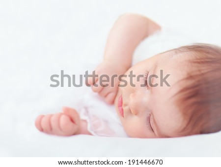 beautiful sleeping baby girl on white - stock photo