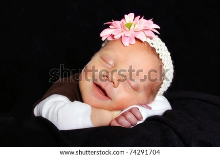 beautiful sleeping baby girl with a smile on her face
