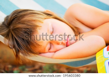 beautiful sleeping baby lies in the hammock - stock photo