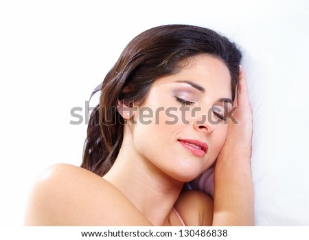 Beautiful sleeping woman in the bedroom. Relax.