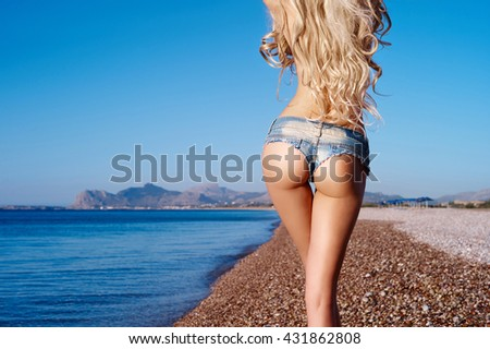 Beautiful slender blonde at the sea. Summer travel photos - stock photo