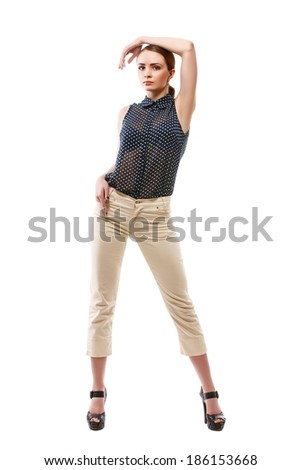 Beautiful slender girl posing in studio, isolated on a white background