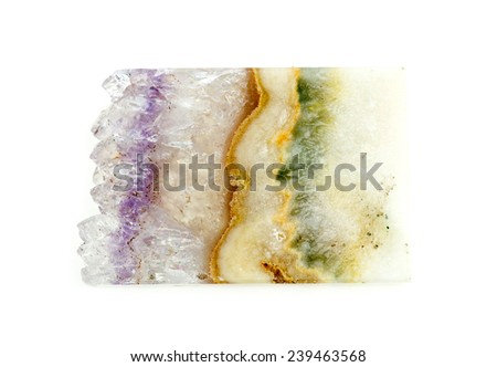 Beautiful slice of quartz geode gemstone with layers of moss and lace agate - stock photo
