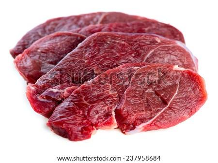 Beautiful slices of organic Australian raw uncooked lamb leg steaks - stock photo