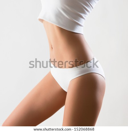 Beautiful slim body of woman in lingerie - stock photo