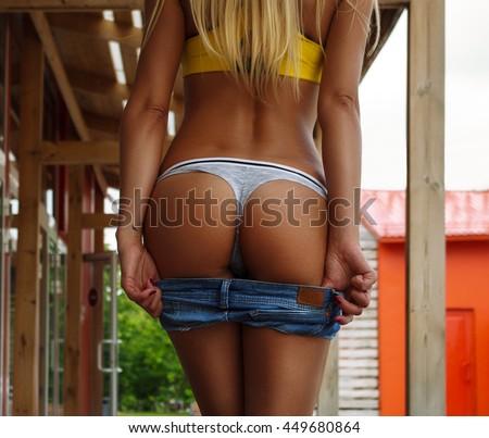Beautiful slim female body. Back view. - stock photo