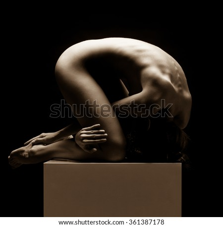 Beautiful slim female body on a dark background. Voluptuous woman's shape with clean healthy skin, muscle tonus. Spa beauty part of body. Healthy lifestyle, diet and fitness. Sepia tone. - stock photo