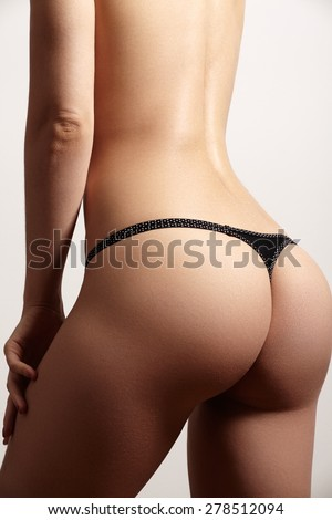 Beautiful slim female body. Voluptuous woman's shape with clean healthy skin, flat stomach. Spa beauty part of body. Healthy lifestyle, diet and fitness. Perfect waist, butt and legs