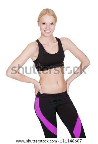 Beautiful slim fitness woman. Isolated on white