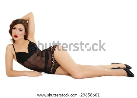 Beautiful slim girl in sexy black lingerie lying on white background