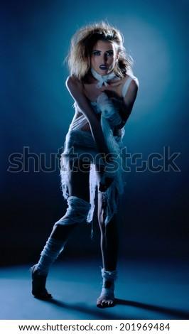 Beautiful slim girl posing dressed as mummy - stock photo