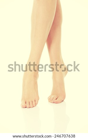 Beautiful slim smooth shaved legs and feet.  - stock photo