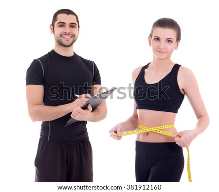 beautiful slim sporty woman with personal trainer isolated on white background - stock photo