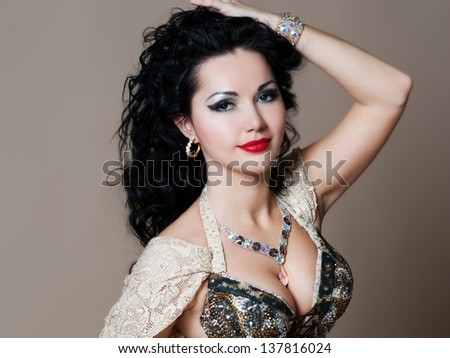 beautiful slim woman belly dancer sexy arabian turkish oriental professional artist in carnival shining costume with long healthy glossy hair. exotic star of bellydance - stock photo