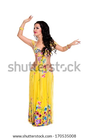 beautiful slim woman belly dancer sexy arabian turkish oriental professional artist in carnival shining costume with long healthy glossy hair. exotic star of bellydance.  - stock photo
