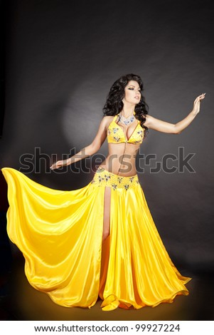 beautiful slim woman belly dancer sexy arabian turkish oriental professional artist in carnival shining costume with long healthy glossy hair. exotic star of bellydance. spring-summer - stock photo