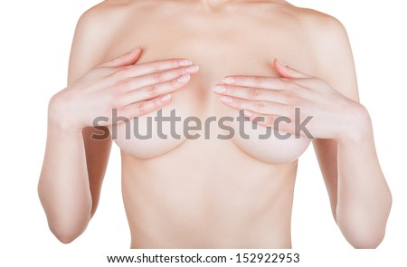 Beautiful slim woman covering her nude breast isolated on white background