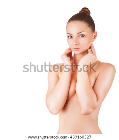 Beautiful slim woman covers her bare breasts. Isolated on white background