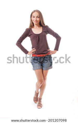 Beautiful slim woman in shorts, isolated on white background - stock photo