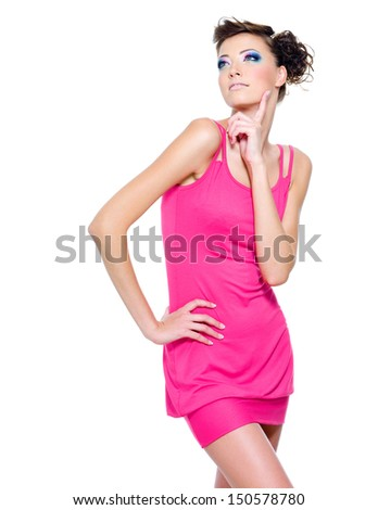 Beautiful slim woman posing in pink dress isolated on white - stock photo