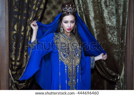 beautiful slim woman sexy arabian turkish oriental professional artist in carnival shining costume with long healthy glossy hair.  - stock photo