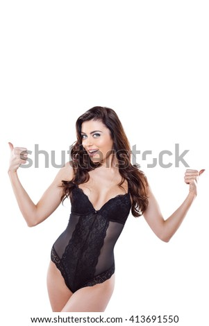 Beautiful slim woman wearing black lace lingerie. Studio shot of young seductive woman isolated on white background. Woman smiling - stock photo