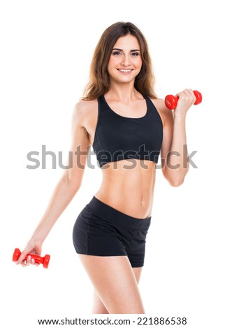 Beautiful slim woman with dumbbells, isolated on white background - stock photo
