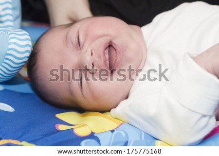 Beautiful small baby is smiling - stock photo