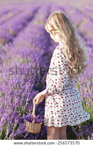 Beautiful small blond girl on the lavender field - stock photo