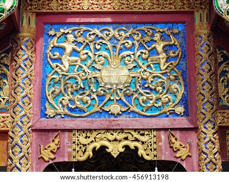 beautiful small buddhism temple building in a province in northern THAILAND with decorative colorful mirror and ceramics ornaments and elements in north THAILAND figures and style . - stock photo