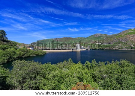 Beautiful small dam from the north of Portugal in spring with deep blue sky and green trees. National Park of Peneda Geres. - stock photo