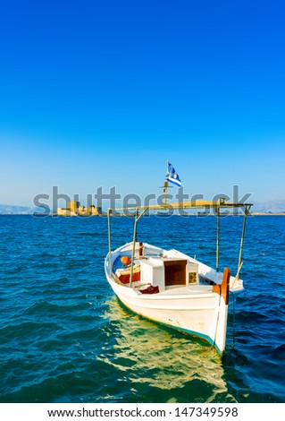 Beautiful small fishing wooden old boat located in Nafplio town in Greece