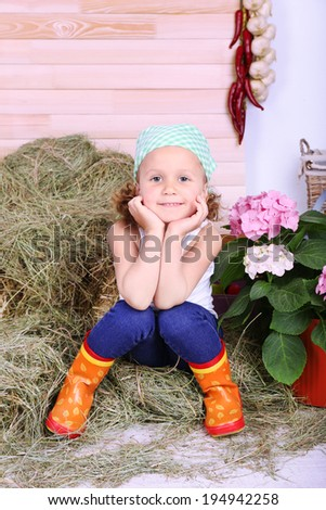 Beautiful small girl on country style background