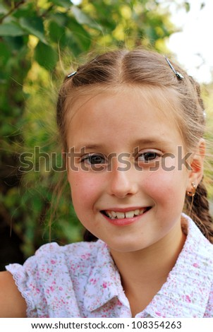 Beautiful small girl outdoors