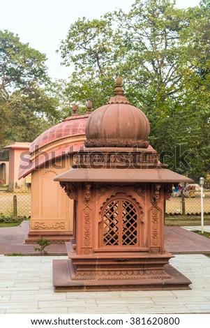 Beautiful small terracotta temples of Lord Krishna in Iscon Mayapur, India. - stock photo