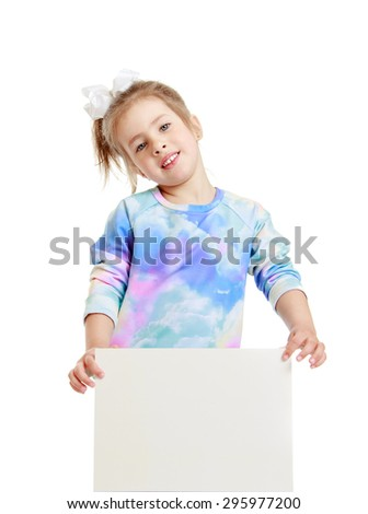 Beautiful, smart, smiling little girl with bow on her head holding in front of a square or rectangular white banner on which you can write ads - isolated on white background - stock photo