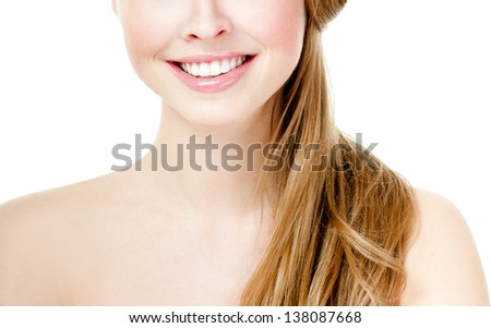 Beautiful smile of a young woman - stock photo
